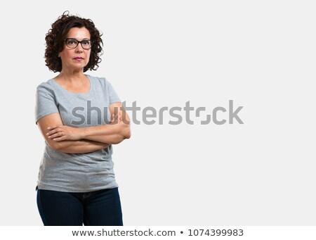 Grave donna matura braccia incrociate piedi bianco uomo Foto d'archivio © wavebreak_media