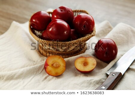 served ripe plums on napkin stock photo © dash