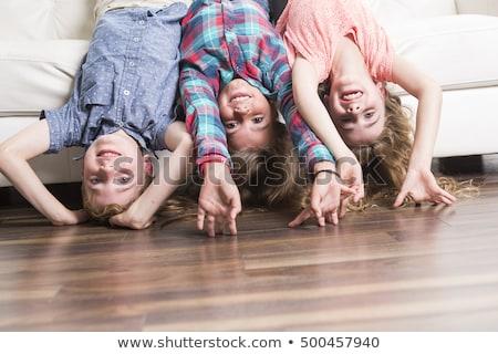 Drie leggen ondersteboven witte sofa home Stockfoto © Lopolo