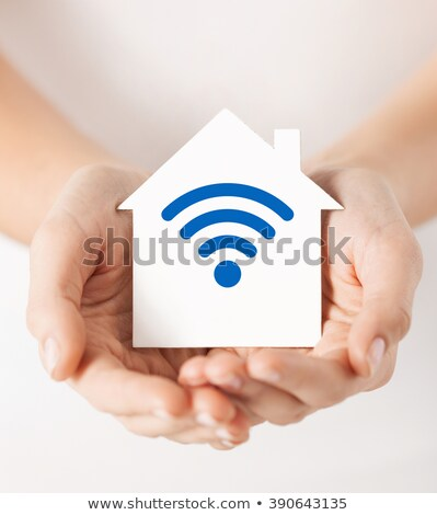 hands holding house with radio wave signal icon Stock photo © dolgachov