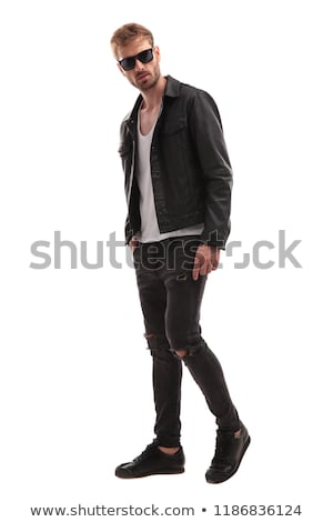 smiling fashion man wearing black leather jacket stands Stock photo © feedough