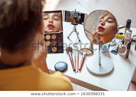 Girl Looking in Mirror Making Up Lips Lipstick Stockfoto © robuart