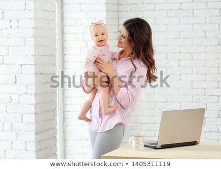 Portrait of a mother with her nine months old baby Stock photo © Lopolo