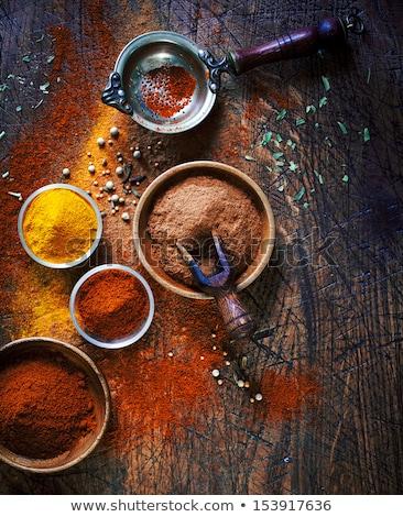 a Chilli pepper on old wooden surface stock photo © galitskaya
