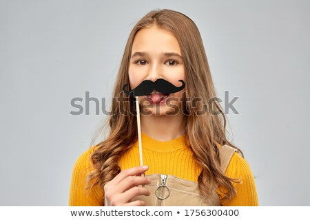 teenage girl with party prop showing tongue Stock photo © dolgachov