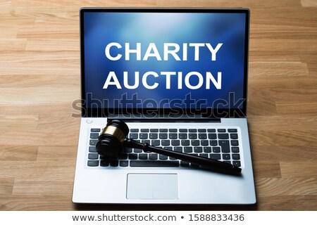 Charity Auction Word On Digital Tablet Near Gavel Stock photo © AndreyPopov