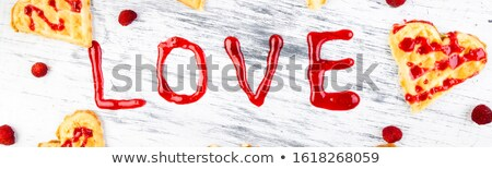 Banner with Belgian heart shaped waffle on white background. Word love made by jam. Stock photo © Illia
