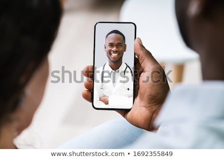 Couple Videoconferencing With Doctor On Mobile Phone Stock photo © AndreyPopov