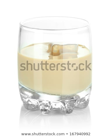 Glass of Irish cream baileys liqueur with ice cubes,coffee beans and powder with dark chocolate and  Stock photo © DenisMArt