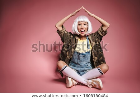 Image of asian girl in white wig making roof above her head with Stock photo © deandrobot