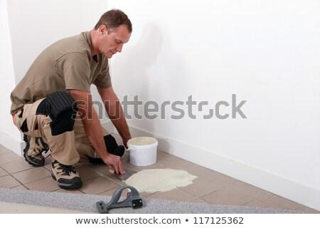 Szőnyeg jelentkezik tapadó öreg csempézett padló Stock fotó © photography33