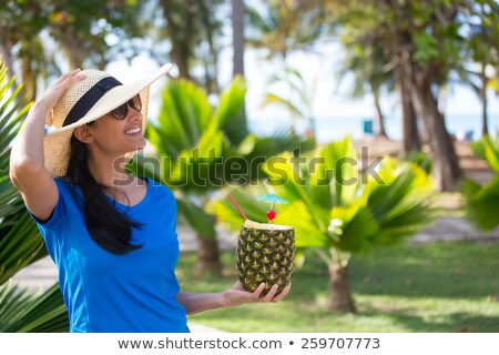 Closeup portrait of daydreaming woman holding pineapple fruit we Stock photo © HASLOO
