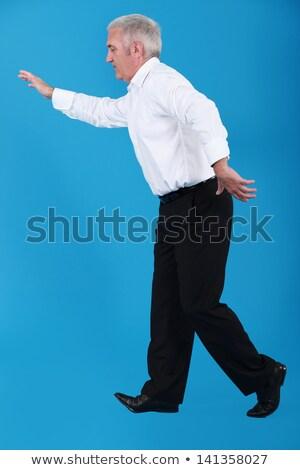 Idős üzletember sétál láthatatlan szoros kötél Stock fotó © photography33