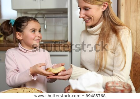 Little girl giving her mother a crepe Stock photo © photography33