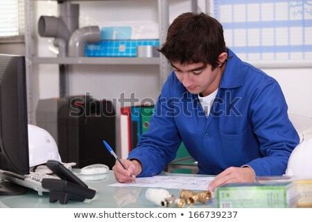 Young apprentice checking stock Stock photo © photography33