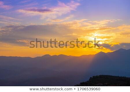 sunset over hills stock photo © jkraft5