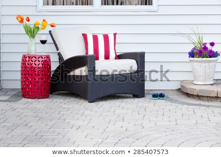 Single armchair with a red pedestal table Stock photo © ozgur