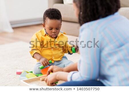 Jongen moeder houten speelgoed familie hand gelukkig Stockfoto © Paha_L