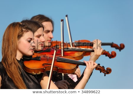 trio of violinists plays against sky Stock photo © Paha_L