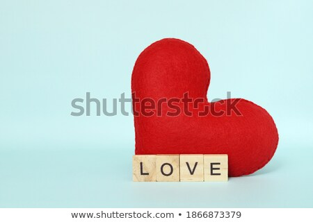 Stock photo: Red heart shape ewith an inscription love made from wool on old
