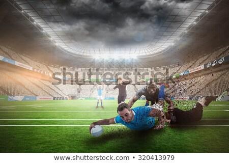 Rugby speler juichen wijzend witte sport Stockfoto © wavebreak_media