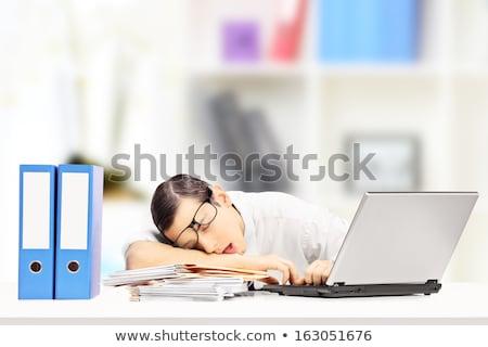 Kimerült fiatal üzletember alszik asztal iroda Stock fotó © deandrobot