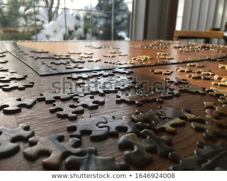 Puzzle on wooden table Stock photo © fuzzbones0