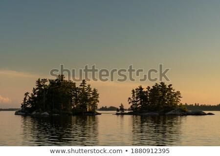 Tarde tarde lago espejo montanas Foto stock © wildnerdpix