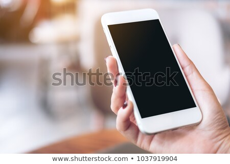 Close up of female hands using smartphone device Stock photo © stevanovicigor