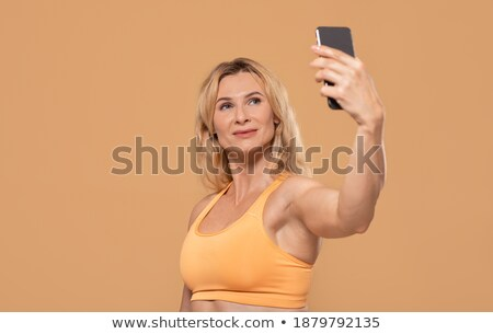 strong sports lady make sport exercises in gym stock photo © deandrobot