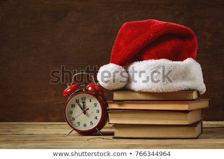 Book stack and christmas decoration on wooden plank Stock photo © wavebreak_media