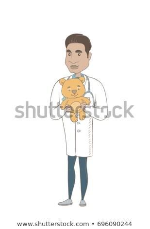 Genç koyu esmer çocuk doktoru oyuncak ayı doktor Stok fotoğraf © RAStudio