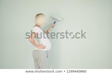 беременная женщина Живопись питомник женщину семьи краской Сток-фото © IS2