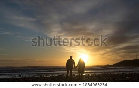 Paar knuffelen strand man natuur zand Stockfoto © IS2