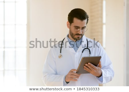 Doctor browsing patient files Stock photo © IS2