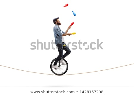 A Man Juggling on White Background Stock photo © bluering