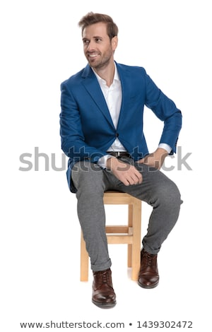 attractive smart casual man sitting and looking to side stock photo © feedough