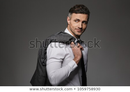 image of brunette businessman 30s smiling and holding jacket ove stock photo © deandrobot