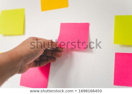 Kéz designer tart öntapadó jegyzet ötlet üzlet Stock fotó © dolgachov