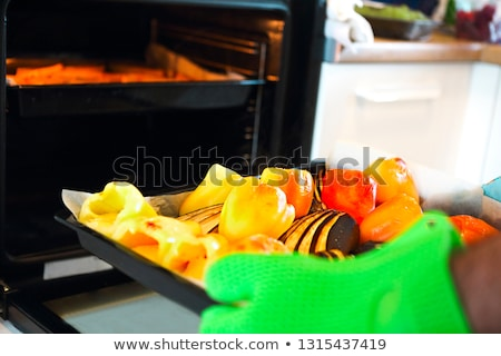 Close up shot of roast pepper and eggplant in a tray Stock photo © dashapetrenko