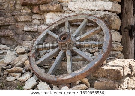 Fából készült vagon kerekek hagyományos akasztás fal Stock fotó © jeayesy