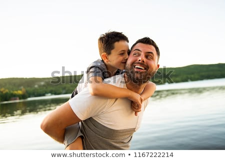 father and son on the pier warm summer day having good time Stock photo © Lopolo