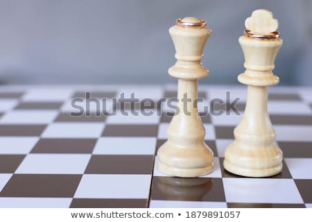 wedding rings with chess pieces stock photo © stoonn