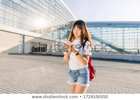 Vista lateral mulher telefone móvel sessão quintal casa Foto stock © wavebreak_media