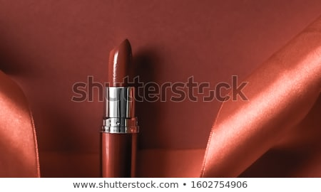 luxury lipstick and silk ribbon on bronze holiday background ma stock photo © anneleven