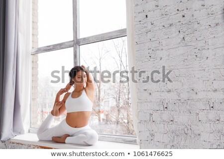 Kadın atlet beyaz duvar kadın Stok fotoğraf © ElenaBatkova
