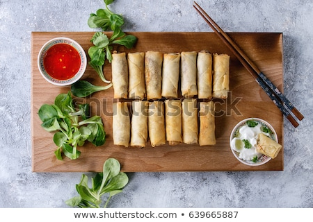 Fried spring rolls served with salad and sauce. Traditional Indonesian and Asian dish Stock photo © galitskaya