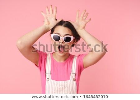 Photo joyeux charmant fille lunettes de soleil Photo stock © deandrobot