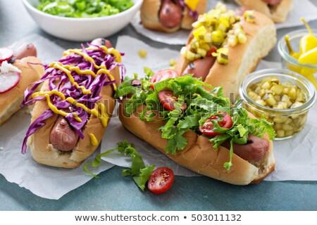 Hot dog zöldségek saláta fűszerek fából készült felső Stock fotó © karandaev