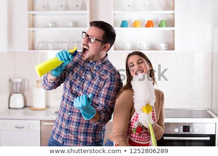 man with broom cleaning and having fun at home Stock photo © dolgachov